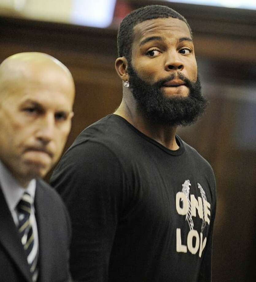 New York Jets wide receiver Braylon Edwards is arraigned on charges of Driving Wile Intoxicated Tuesday in New York. Police pulled over Edwards' Land Rover on Manhattan's west side around 5:15 a.m. because the windows on his vehicle were too tinted, police said. Officers on the scene noticed a strong smell of alcohol and administered a breath test. Edwards was arrested after failing the test and a second test given to him at the police station. At left is his attorney, Peter Frankel. (AP Photo/Steven Hirsch, Pool) Photo: AP / POOL NEW YORK POST