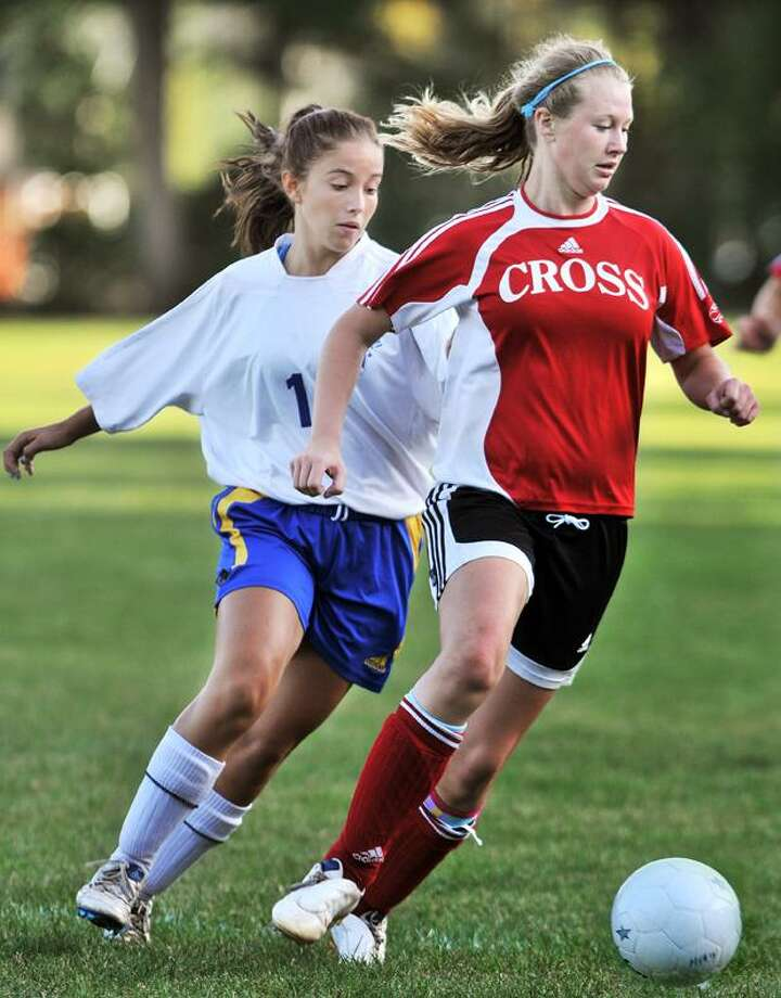 """The Middletown Press  9.19.11 Mercy junior forward Sara Richardson keeps the ball in possession in the second half against the Wilbur Cross/Career/Hillhouse co-op team. Mercy defeated CCH 2-1 Monday afternoon at home. To buy a print of this photo and more, visit <a href=""""http://www.middletownpress.com"""">www.middletownpress.com</a>"""