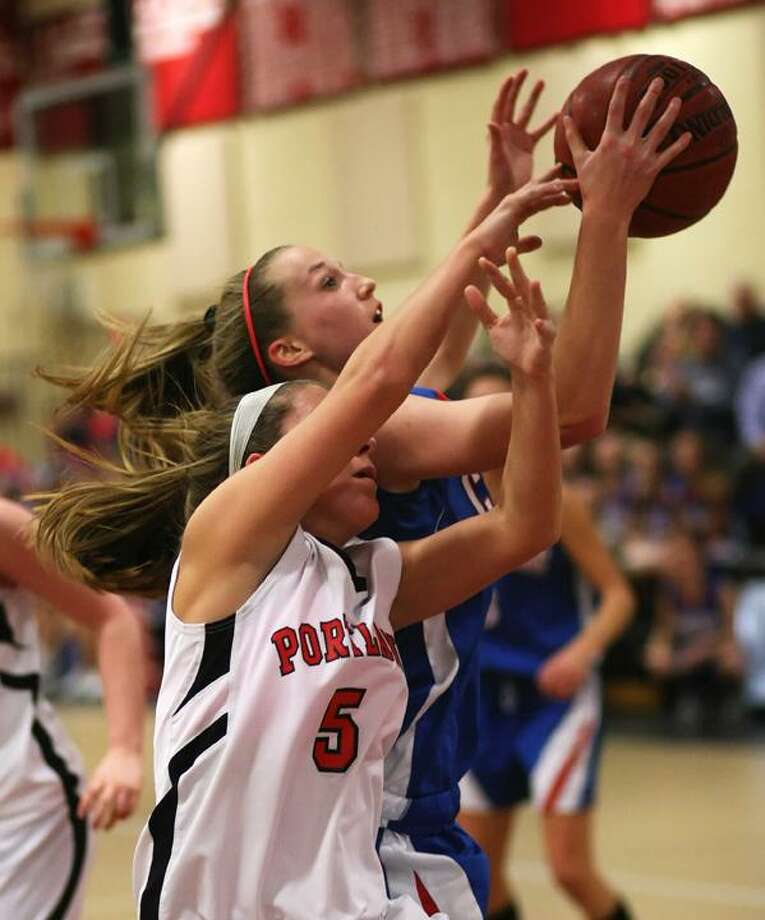 Todd Kalif/Special to the Press Coginchaug's Samantha Mancinelli drives past Portland's Meaghan Rodgers in Thursday night's game in Portland.