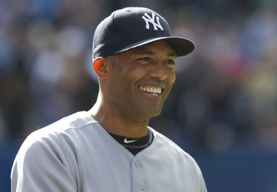 ASSOCIATED PRESS New York Yankees closer Mariano Rivera smiles after tying the Major League Baseball all-time saves record following a 7-6 win over the Toronto Blue Jays Saturday in Toronto. Rivera tied Trevor Hoffman with 601 career saves.