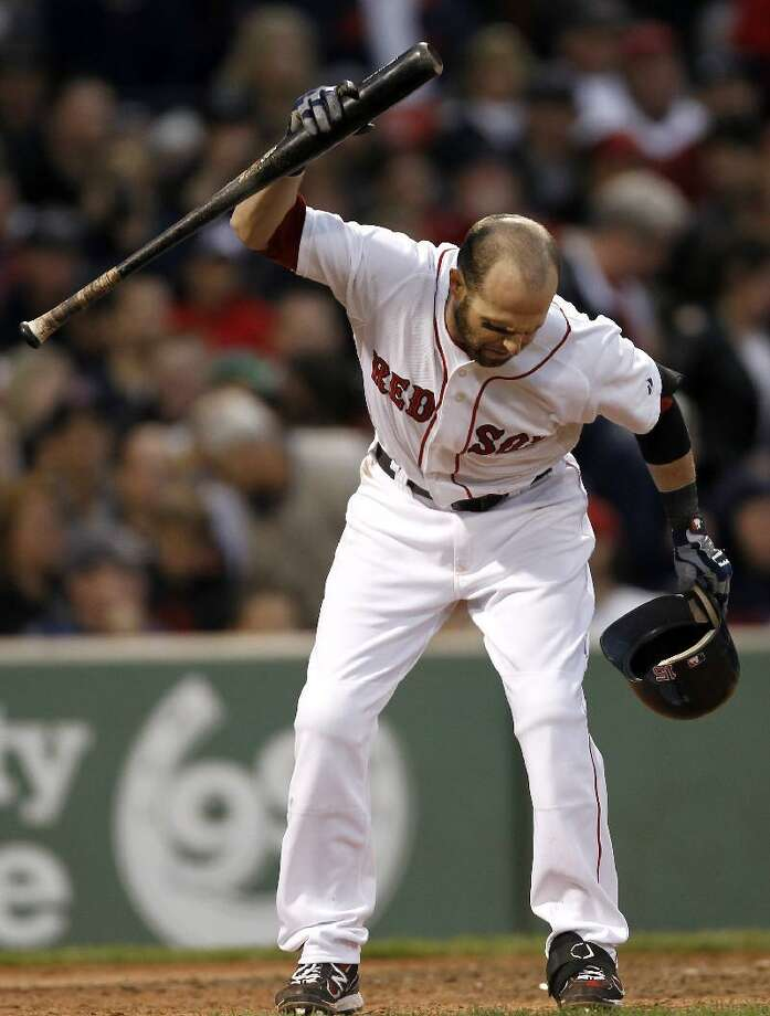 ASSOCIATED PRESS Boston Red Sox second baseman Dustin Pedroia throws his bat down after striking out to end the seventh inning of Saturday's game against the Tampa Bay Rays at Fenway Park in Boston. The Red Sox lost 4-3.