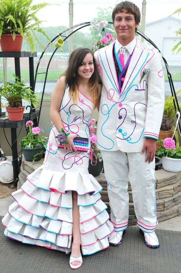 Viktoria Sundqvist I The Middletown PressPortland High School senior Alyssa Danielewicz with junior Frankie Fazzino show off the clothes Danielewicz created of duct tape that they wore to the prom.