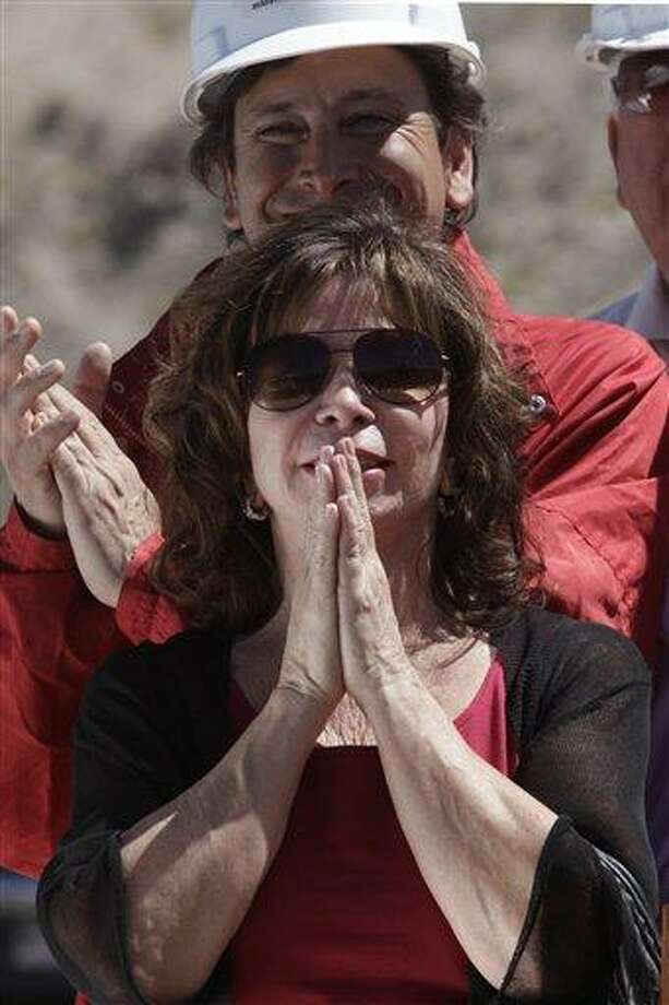 Chilean writer Isabel Allende Llonas gestures before talking in support of the trapped miners and their relatives outside the San Jose mine in Copiapo, Chile, Sunday, Sept. 19, 2010. Thirty-three miners have been trapped deep underground in the copper and gold mine since it collapsed on Aug. 5. At back is Chile's Mining Minister Laurence Golborne. (AP Photo/Aliosha Marquez) Photo: AP / AP