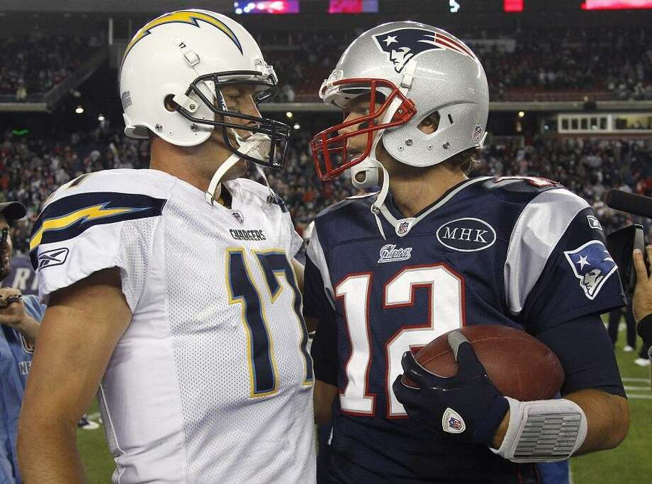 New England Patriots quarterback Tom Brady, right, is congratulated by San Diego Chargers quarterback Philip Rivers after an NFL football game in Foxborough, Mass., Sunday Sept. 18, 2011. The Patriots beat the Chargers 35-21. (AP Photo/Charles Krupa) Photo: ASSOCIATED PRESS / AP2011
