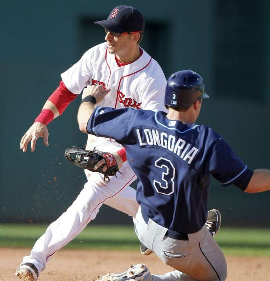 Tampa Bay Rays' Evan Longoria (3) steals second base as Boston Red Sox's Marco Scutaro waits for the throw in the seventh inning of a baseball game on Sunday, Sept. 18, 2011. (AP Photo/Michael Dwyer) Photo: ASSOCIATED PRESS / AP2011