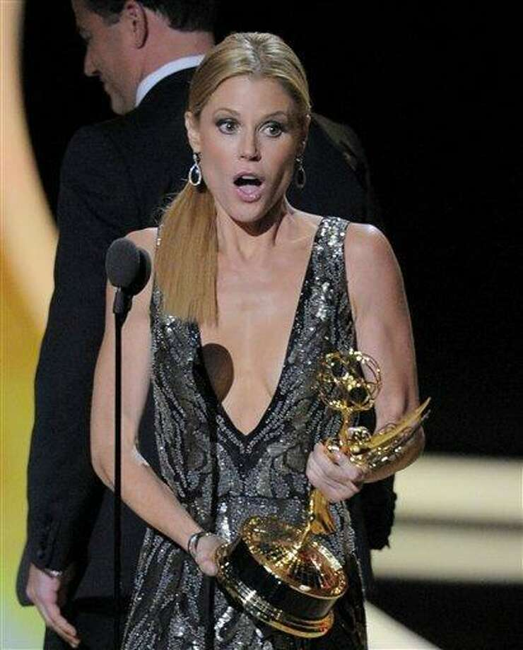 """Julie Bowen accepts the award for outstanding supporting actress in a comedy series for """"Modern Family"""" at the 63rd Primetime Emmy Awards Sunday. Photo: ASSOCIATED PRESS / AP2011"""