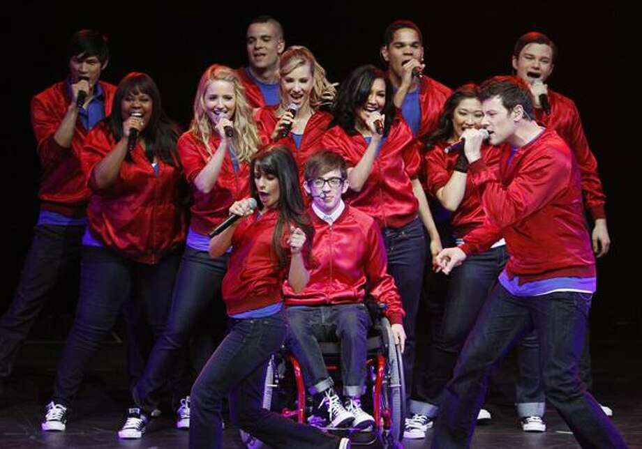 """The cast of the popular television show """"Glee"""" including Lea Michele, front left, and Cory Monteith, front right, perform during a concert to kickoff a national """"Glee"""" tour at the Dodge Theatre Saturday in Phoenix. Photo: ASSOCIATED PRESS / AP2010"""