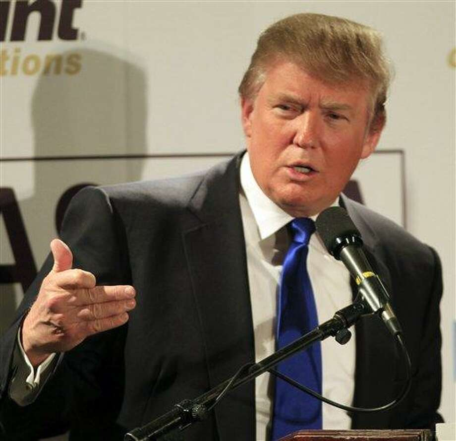 FILE - In this May 11, 2011 file photo, possible 2012 presidential hopeful, Republican Donald Trump speaks during a luncheon with the Greater Nashua Chamber of Commerce in Nashua, N.H. Trump announced, Monday, May 16, 2011 that he won't seek the Republican nomination. (AP Photo/Jim Cole) Photo: AP / AP
