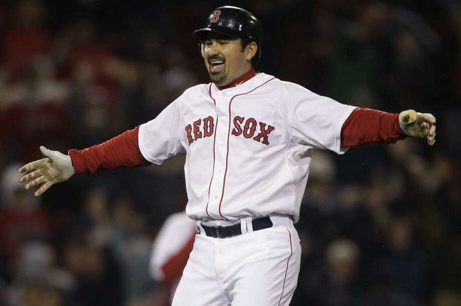 Boston Red Sox's Adrian Gonzalez celebrates after his game-winning, two-run double against the Baltimore Orioles in the ninth inning of a baseball game at Fenway Park in Boston, Monday, May 16, 2011. The Red Sox won 8-7. (AP Photo/Charles Krupa) Photo: ASSOCIATED PRESS / AP2011
