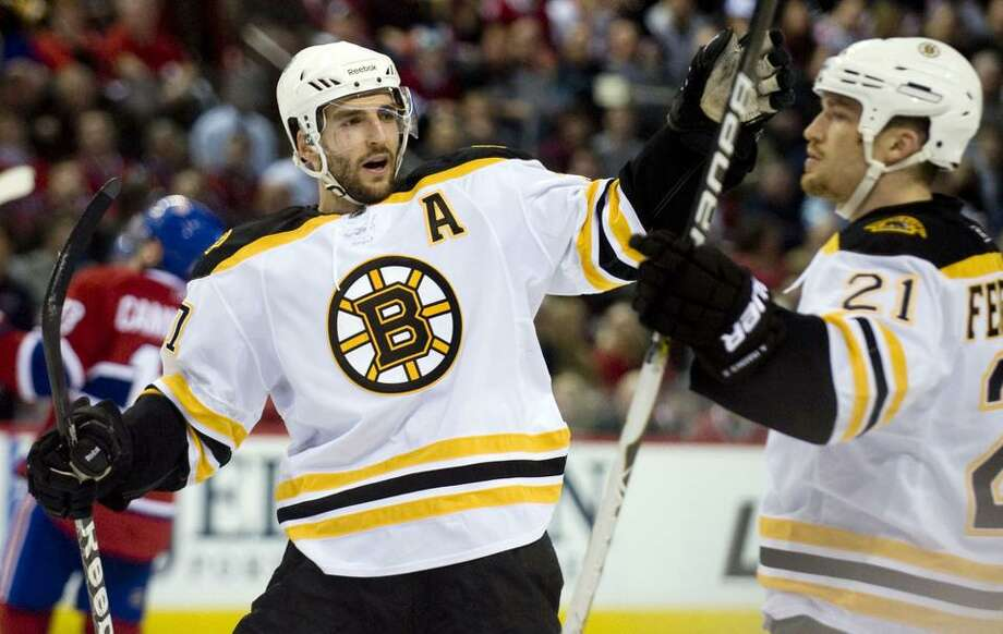 Boston Bruins' Andrew Ference (21) celebrates with teammate Patrice Bergeron, after scoring against the Montreal Canadiens during second period of Game 4 of a first-round NHL Stanley Cup playoff series against the Montreal Canadiens in Montreal, Thursday, April 21, 2011. (AP Photo/The Canadian Press, Graham Hughes) Photo: ASSOCIATED PRESS / AP2011