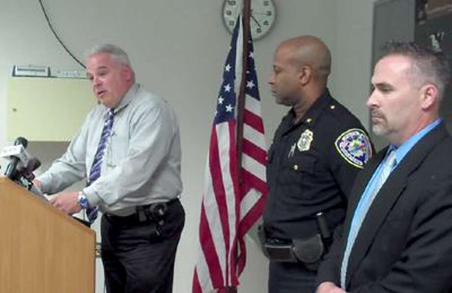 Acting Police Chief Patrick McMahon speaks to the press at the police department on May 17 as Deputy Chief Gregory Sneed and Capt. William McKenna listen.