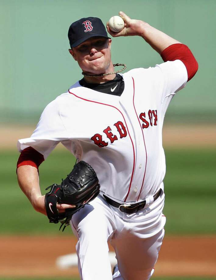 Boston Red Sox's Jon Lester pitches in the first inning of a baseball game against the Toronto Blue Jays, Sunday in Boston. (AP Photo/Michael Dwyer) Photo: ASSOCIATED PRESS / AP