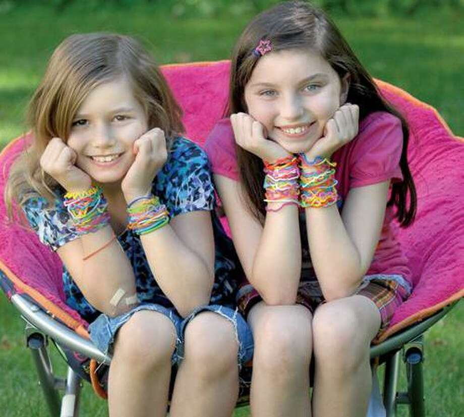 Sasha Samsel, 8, left, and Kelly Sandella, 9, both of Guilford, show off their Silly Bandz bracelet collection. Mara Lavitt/Register