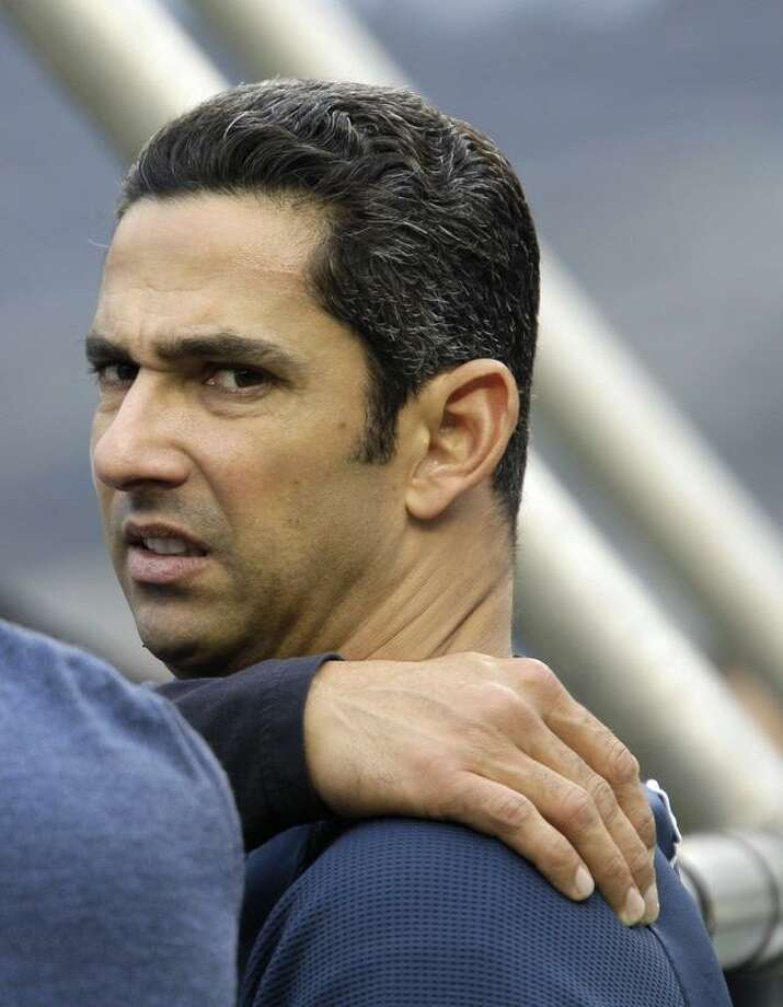 New York Yankees designated hitter Jorge Posada rubs his left shoulder as he glances back from the batting cage while waiting his turn to take batting practice before the Yankees baseball game against the Boston Red Sox at Yankee Stadium Sunday, May 15, 2011 in New York. (AP Photo/Kathy Willens) Photo: ASSOCIATED PRESS / AP2011