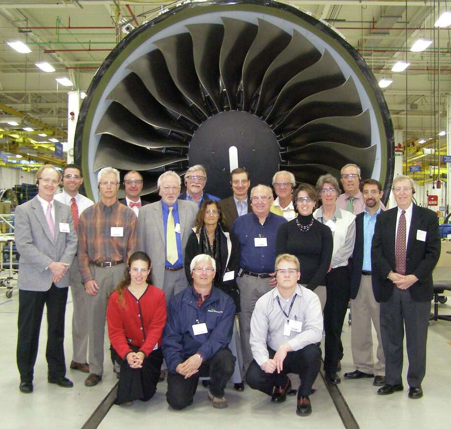 Members of the Chamber's Manufacturers Council stand in front of a Pratt & Whitney GP7000 engine, a commercial engine used to power the Airbus A380 airplane.