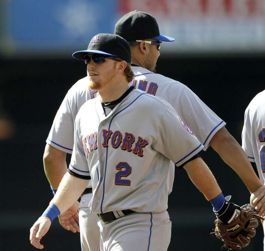 New York Mets second baseman Justin Turner (2) is celebrates with teammates after beating the Houston Astros in a baseball game Sunday, May 15, 2011, in Houston.The Mets beat the Astros 7-4. (AP Photo/David J. Phillip) Photo: ASSOCIATED PRESS / AP2011