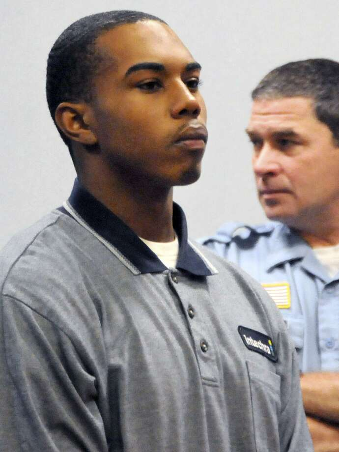 In this Oct. 28, 2009, file photo, John William Lomax III is arraigned in Superior Court in Vernon on charges connected with the slaying of University of Connecticut football star Jasper Howard. Prosecutors said during a hearing in Vernon Friday that they have turned over only 3/4 of the evidence in the discovery phase of the case. A trial this fall is unlikely. (AP Photo/George Ruhe, File) Photo: AP / AP2009