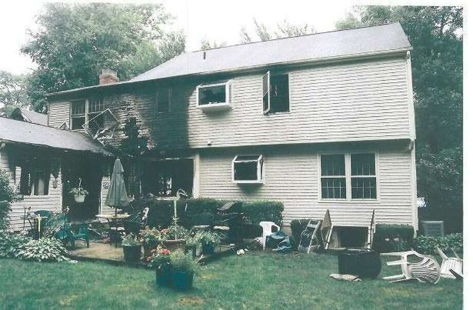 The Petit home after it was set ablaze on July 23, 2007. (Evidence photo from state Judicial Branch)