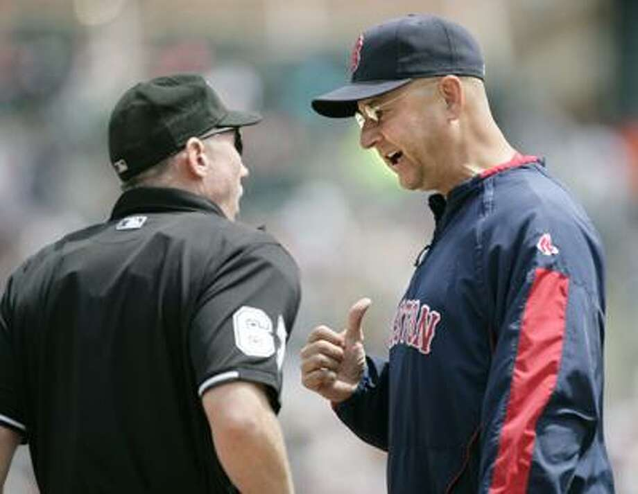 Boston Red Sox manager Terry Francona, right, argues with home plate umpire Lance Barksdale after Detroit Tigers' Johnny Damon walked with the bases loaded in the second inning of a baseball game on Sunday. (AP) Photo: AP / FR38952 AP