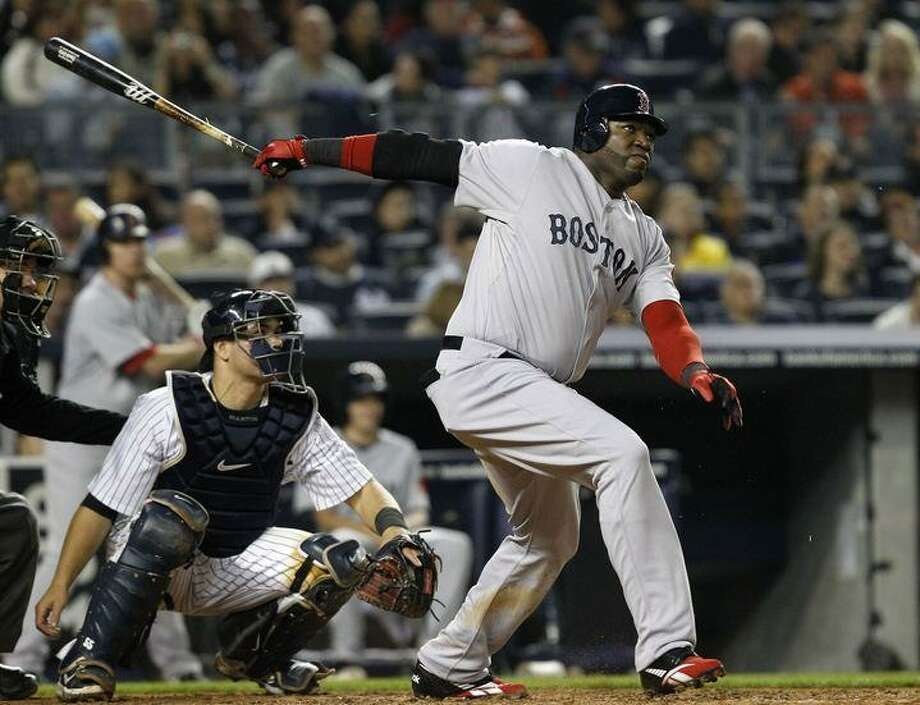 New York Yankees catcher Russell Martin watches as Boston Red Sox designated hitter David Ortiz follows through on a fifth-inning, solo home run off New York Yankees starting pitcher Freddy Garcia in their baseball game at Yankee Stadium Sunday, May 15, 2011 in New York. (AP Photo/Kathy Willens) Photo: ASSOCIATED PRESS / AP2011