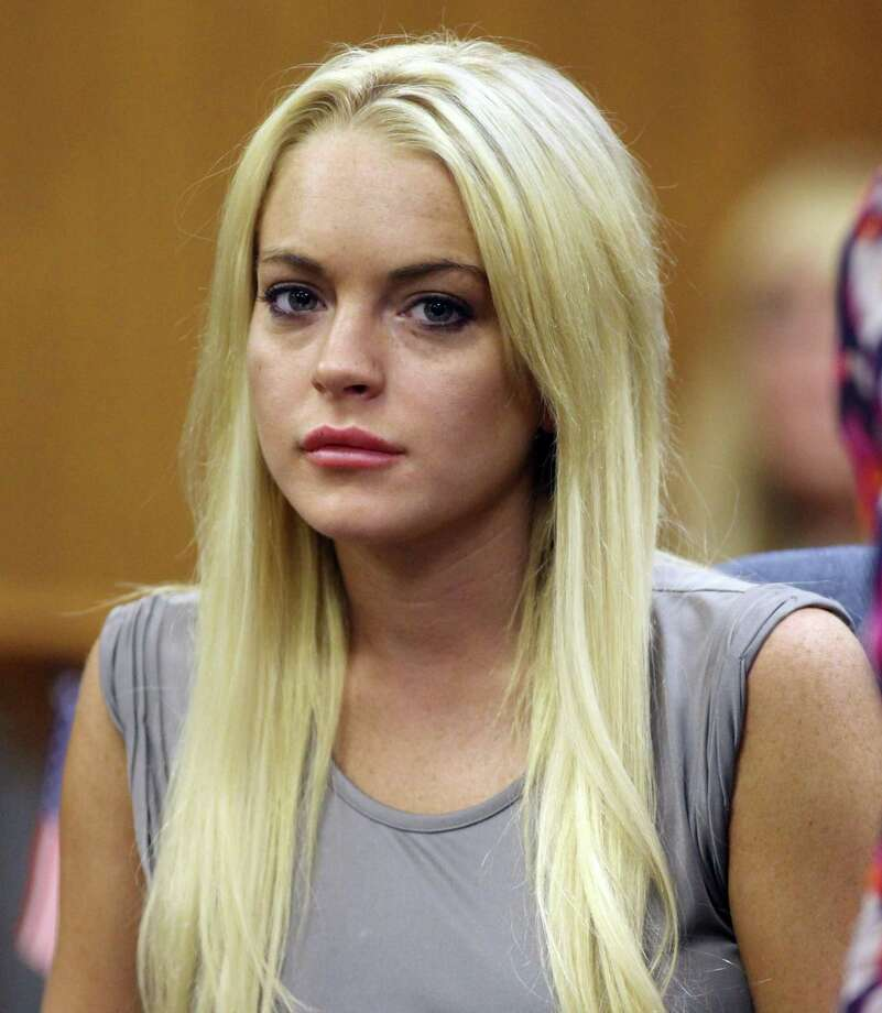 In this July 20 photo, Lindsay Lohan is shown in court in Beverly Hills, Calif., where she was taken into custody to serve a jail sentence for probation violation. A prosecutor and Lindsay Lohan's attorney are due in court Wednesday Aug. 25 to discuss the next step after the actress' release from rehab. (AP Photo/Al Seib, file) Photo: ASSOCIATED PRESS / Pool The Los Angeles Times