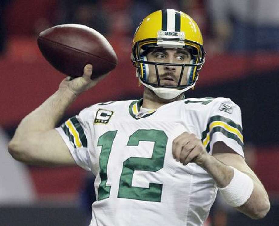 Green Bay Packers quarterback Aaron Rodgers passes against the Atlanta Falcons during the second half of an NFL divisional playoff football game on Saturday, Jan., 15, 2011, in Atlanta. (AP Photo/Patrick Semansky) / 2011 Associated Press