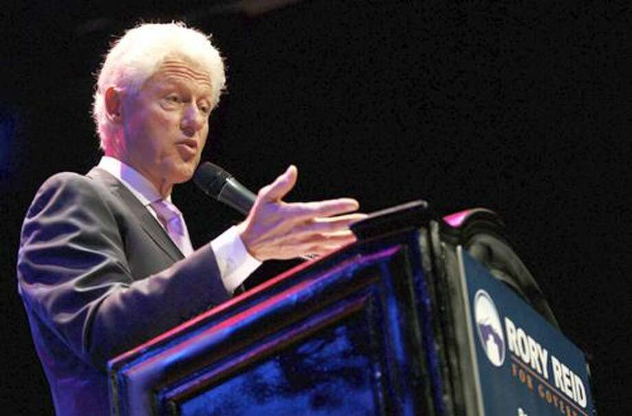 Former U.S. president Bill Clinton, right, speaks at a campaign rally for Nevada gubernatorial candidate Rory Reid on Wednesday, Sept. 15, 2010, Las Vegas. (AP Photo/Jessica Ebelhar, Pool) Photo: ASSOCIATED PRESS / LAS VEGAS REVIEW-JOURNAL, Pool