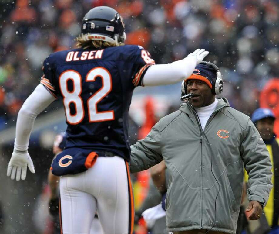 Chicago Bears head coach Lovie Smith celebrates with tight end Greg Olsen (82) after Olsen's touchdown reception against the Seattle Seahawks during the first half an NFL divisional playoff football game Sunday, Jan. 16, 2011, in Chicago. (AP Photo/Jim Prisching)