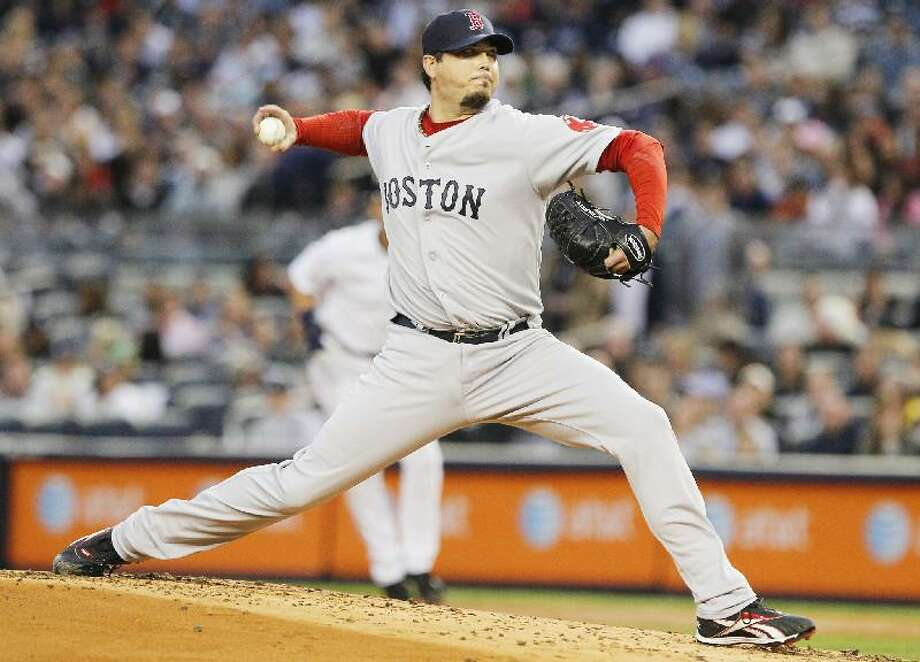 ASSOCIATED PRESS Boston Red Sox starter Josh Beckett delivers a pitch during the first inning of Saturday's game against the New York Yankees at Yankee Stadium in New York.