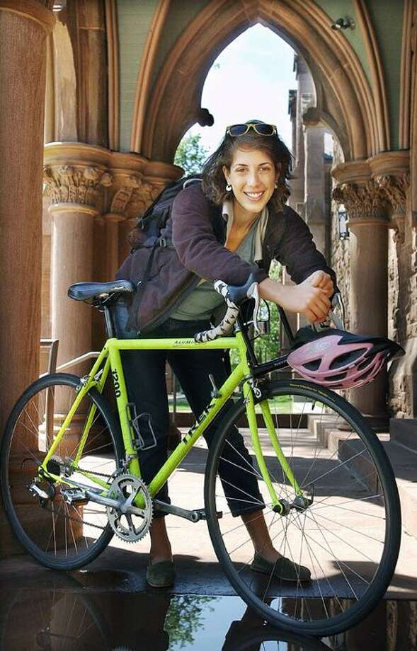 """Wesleyan rising senior Becca Schofield will bike 400 miles through Tanzania in East Africa. To buy a glossy print of this photo and more, visit <a href=""""http://www.middletownpress.com"""">www.middletownpress.com</a>. (Catherine Avalone"""