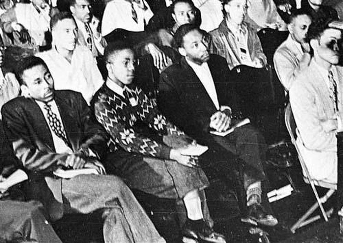 In this 1948 file photo, Martin Luther King, Jr., third from left, listens to a speaker during an assembly at Morehouse College in Atlanta. As a teenager in 1944, King worked on a tobacco farm in Connecticut. That experience influenced his decision to become a minister.