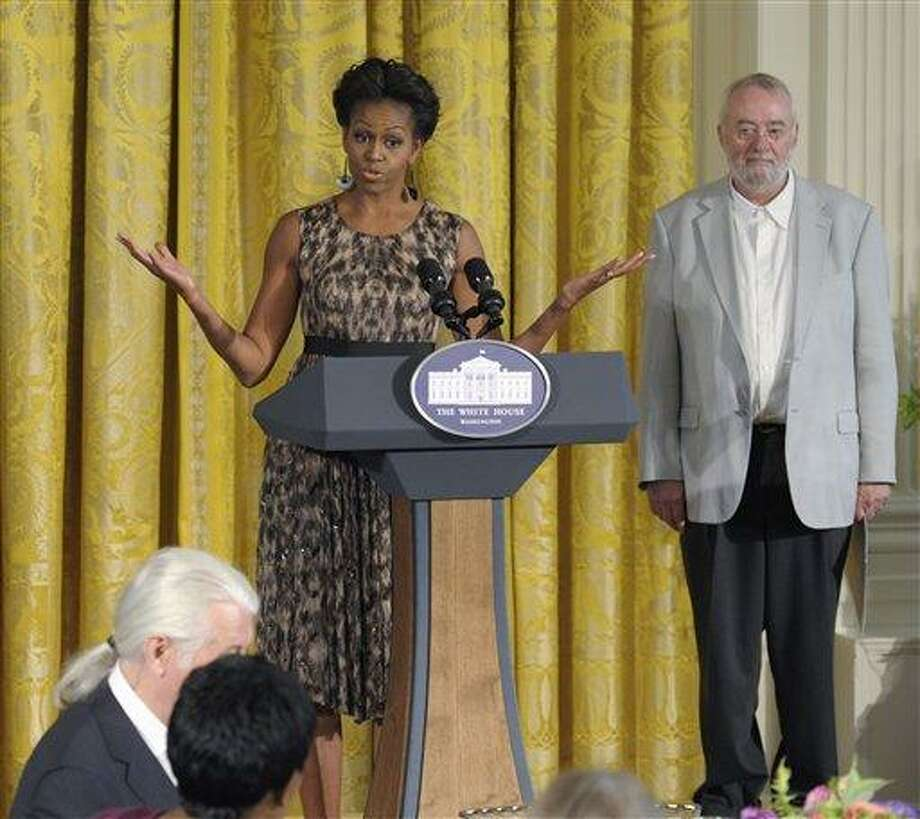 First lady Michelle Obama speaks in the East Room of the White House in Washington, Tuesday, Sept. 13, 2011, during the Smithsonian's Cooper Hewitt National Design Awards luncheon. At right is Bill Moggridge, the director of the Smithsonian's Cooper-Hewitt, National Design Museum,  (AP Photo/Susan Walsh) Photo: AP / AP