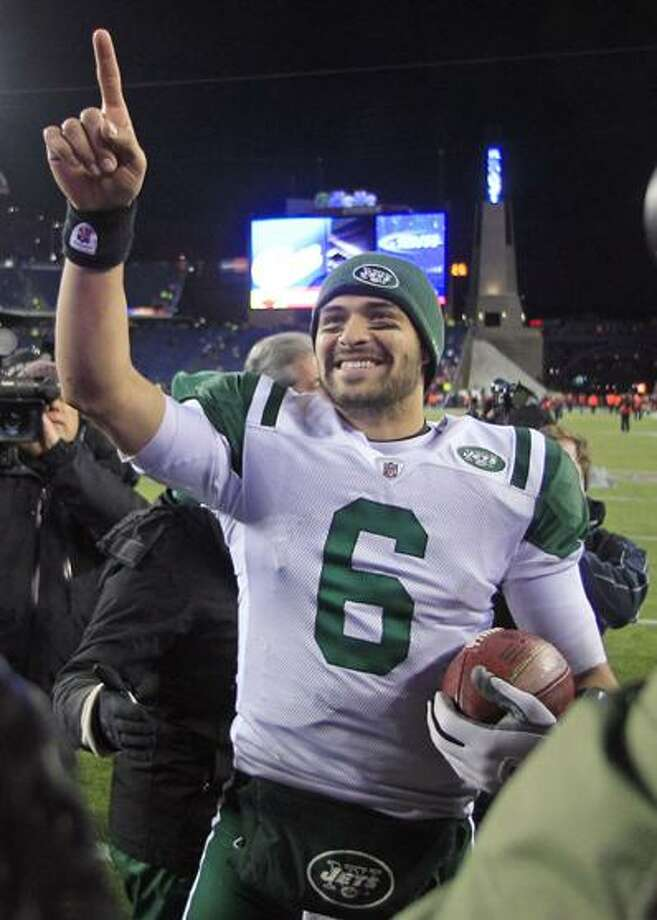 New York Jets quarterback Mark Sanchez celebrates his team's 28-21 win over the New England Patriots in an NFL divisional playoff football game in Foxborough, Mass., Sunday, Jan. 16, 2011. (AP Photo/Charles Krupa)