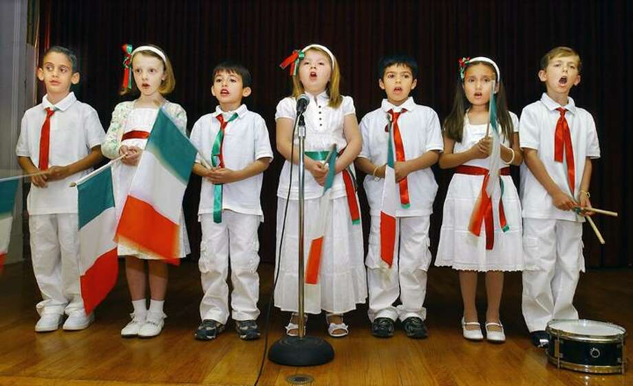 "From left to right, Salvatore Latera, 6, Sydney Whitmore, 7, Dario Rigano, 6, Caroline Rocco, 7, Joseph Rigano, 7, Tiana Morello, 7, and Sebastian Fazzino, 8, are students in the Italian class sponsored by the Italian American Committee on Education (IACE). They performed ""Fratelli d'Italia,"" the Italian National Anthem at a concert at St. Sebastian's Church parish hall. To buy a glossy print of this photo and more, visit <a href=""http://www.middletownpress.com"">www.middletownpress.com</a>."