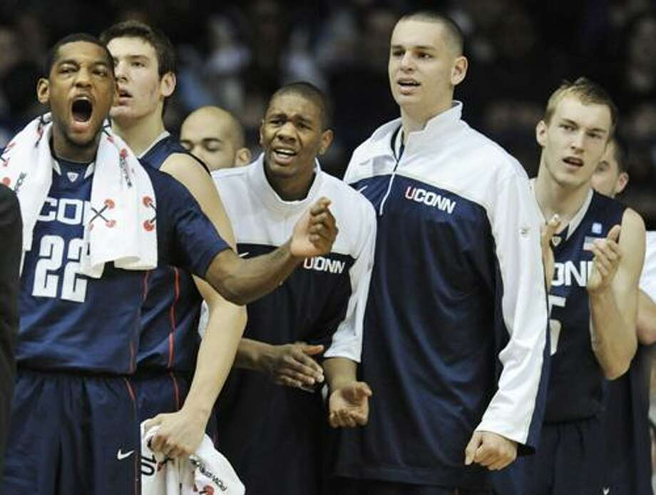 Connecticut players, including Roscoe Smith, left, react on the sideline after Jeremy Lamb dunked against DePaul in the second half of an NCAA college basketball game in Rosemont, Ill., Saturday, Jan. 15, 2011. Connecticut won 82-62. (AP Photo/Paul Beaty) Photo: ASSOCIATED PRESS / AP2011