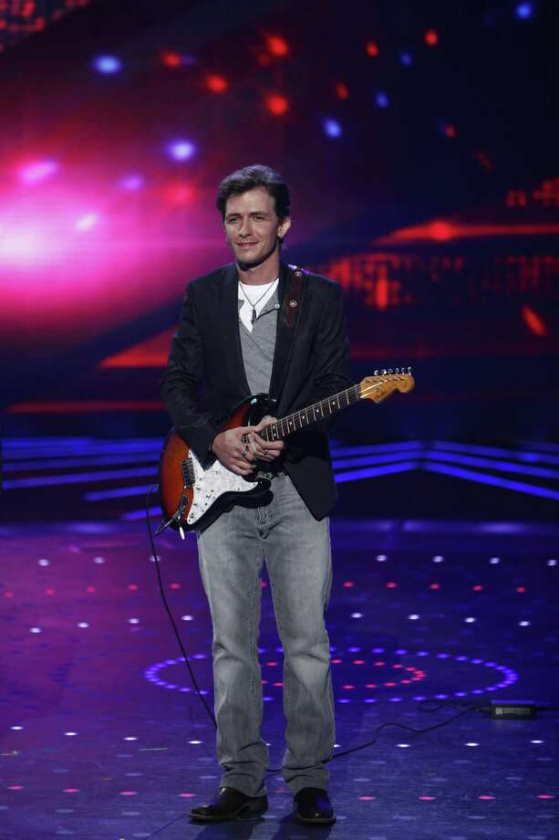 """In this July 20 publicity image released by NBC, contestant Michael Grimm is shown on """"America's Got Talent,"""" in Los Angeles. The Waveland, Miss., native was revealed as the winner of the NBC variety competition on its season conclusion. (AP Photo/NBC, Trae Patton) Photo: AP / ? NBC Universal, Inc."""