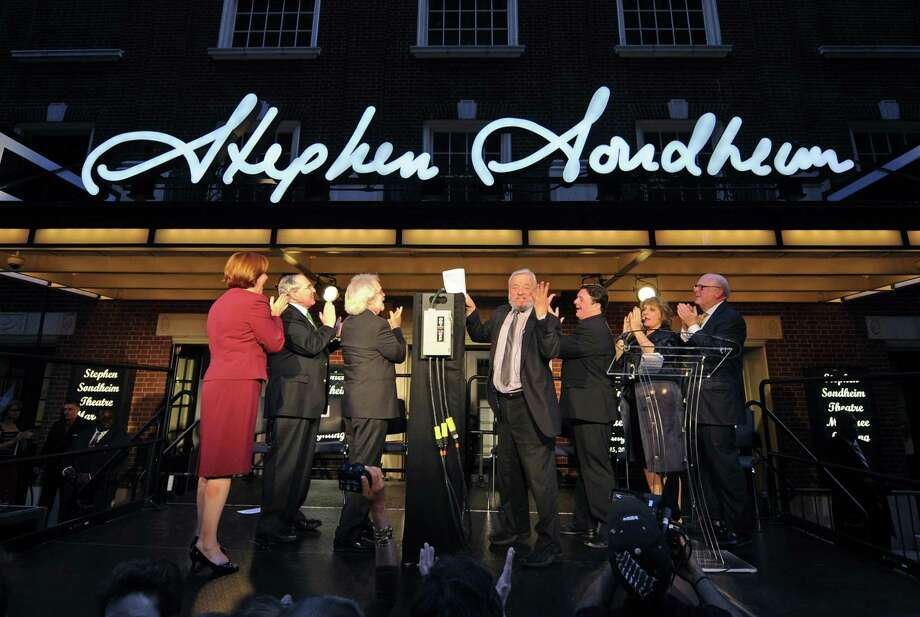 Stephen Sondheim, center, holding paper, is honored by the Broadway community as the lights on the Stephen Sondheim Theatre on West 43rd St. in Times Square are lit for the first time, Wednesday, Sept. 15, 2010. Looking on, from left, are Christine Quinn, speaker of the New York City Council; Todd Haimes, artistic director for the Roundabout Theatre Company; collaborator John Weidman, Sondheim, Nathan Lane, Patti LuPone, and Tom Tuft, chairman of the Roundabout Theatre Company's board of directors. (AP Photo/Henny Ray Abrams) Photo: AP / FR151332 AP