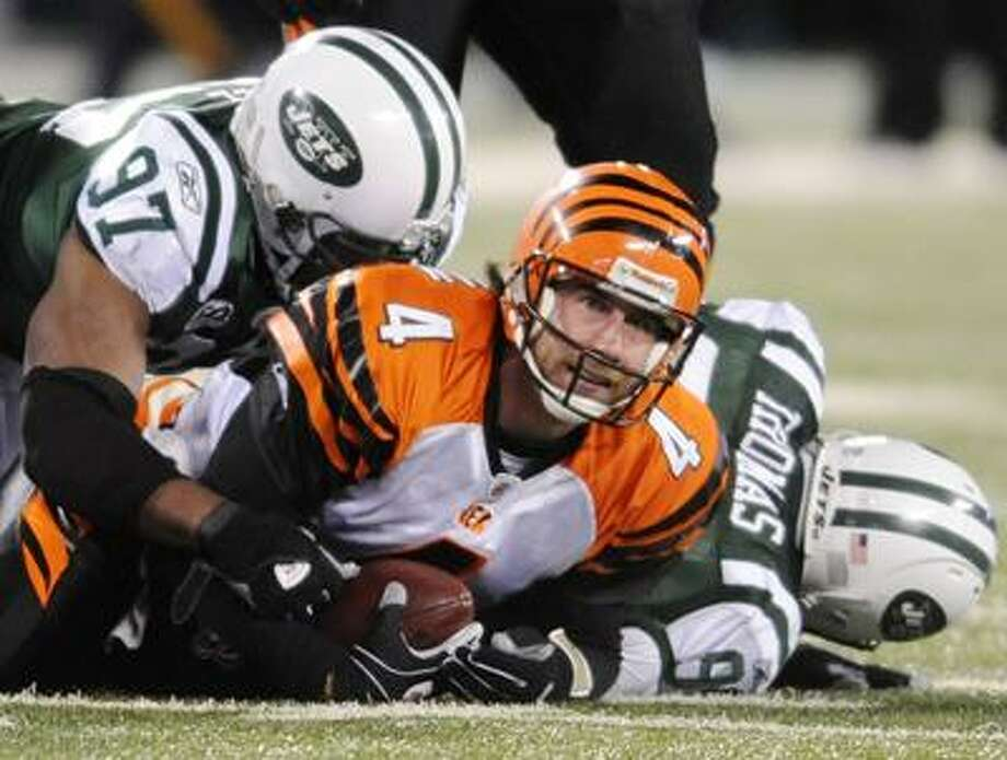 Cincinnati Bengals quarterback J.T. O'Sullivan is sacked for an eight yard loss by New York Jets linebacker Calvin Pace during the third quarter of last Sunday's game. The Jets won the first meeting between the two teams 37-0. The rematch is Saturday in the Wild Card round. (Associated Press) Photo: AP / FR51951 AP