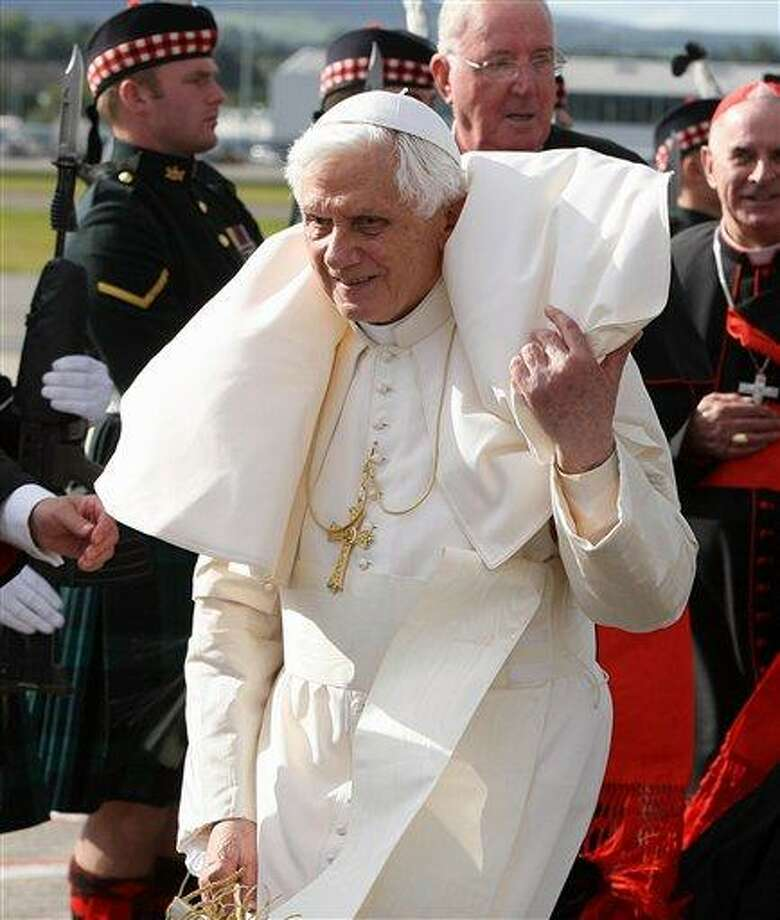 Pope Benedict XVI arrives in Edinburgh, Scotland, on a windy day to begin the first papal state visit to Britain,  Thursday Sept. 16, 2010.  (AP Photo / Andrew Milligan, pool) Photo: AP / pool PA