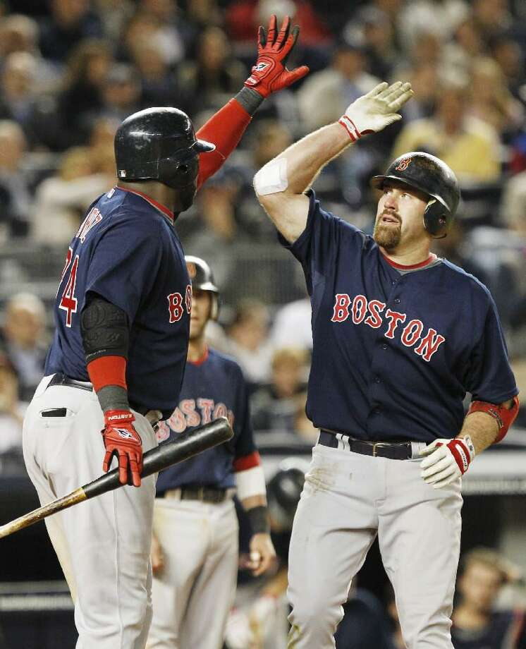 ASSOCIATED PRESS Boston's Kevin Youkilis, right, celebrates with teammate David Ortiz after hitting a two-run home run during the seventh inning of Friday's game against the New York Yankees at Yankee Stadium in New York.