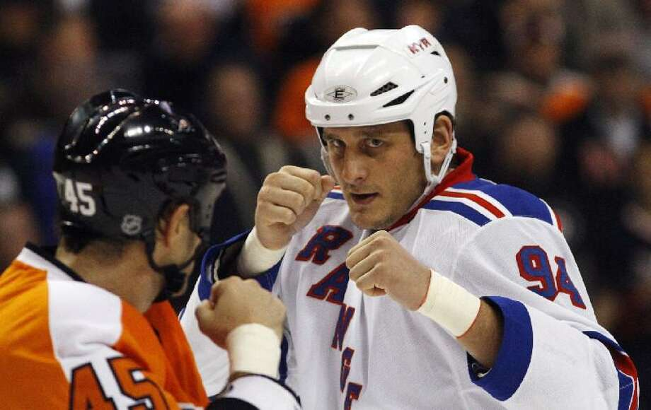 ASSOCIATED PRESS In this Nov. 4, 2010, file photo, Philadelphia's Jody Shelley, left, and New York's Derek Boogaard fight during a hockey game in Philadelphia. Boogaard, at age 28, died on Friday. Boogaard signed with the Rangers as a free agent in July 2010. He appeared in 22 games last season, registering one goal and one assist.
