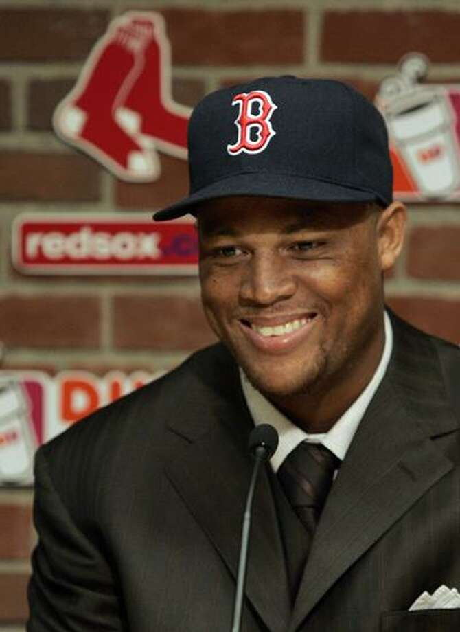 Newly-acquired Boston Red Sox third baseman Adrian Beltre smiles during a baseball news conference introducing him at Fenway Park Friday. (Associated Press) Photo: AP / (2010) Adam Hunger