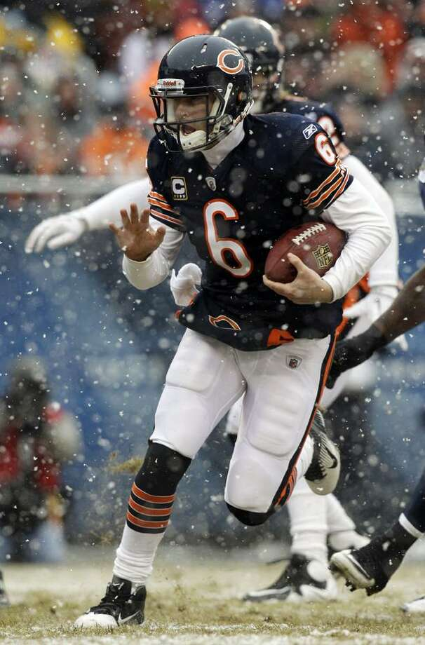 Chicago Bears quarterback Jay Cutler (6) rushes 6 yards for a touchdown against the Seattle Seahawks during the first half an NFL divisional playoff football game Sunday, Jan. 16, 2011, in Chicago. (AP Photo/Jeff Roberson)