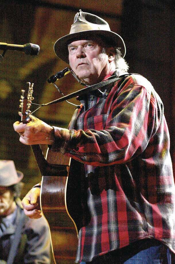 The legendary Neil Young is shown performing on stage. He is set to play the Oakdale Theater on May 23. Photo: John Atashian / Www.concertphoto / John Atashian