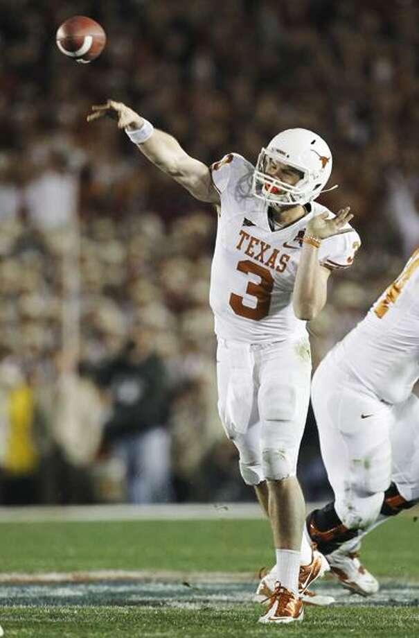 Texas quarterback Garrett Gilbert throws a pass during the the fourth quarter of the BCS Championship. (Associated Press) Photo: AP / AP