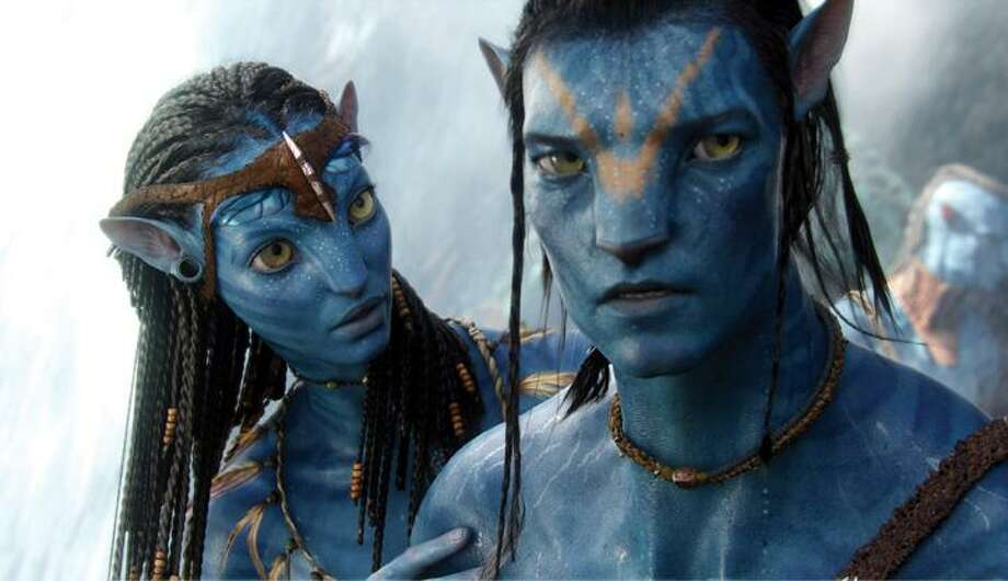 "This undated file photo released by 20th Century Fox shows the character Neytiri, left, played by Zoe Saldana, in a scene from, ""Avatar."" James Cameron's science-fiction epic took in $68.3 million domestically to remain the No. 1 movie for the third-straight weekend, raising its domestic total to $352.1 million in just 17 days. With $670 million more overseas, ""Avatar"" climbed to a worldwide total of $1.09 billion. (AP) Photo: AP / TM & © 2009 Twentieth Century Fox - All Rights Reserved - Not for sale or duplication."