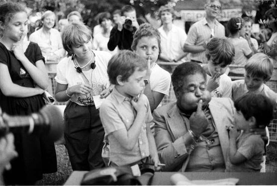 Dizzy Gillespie entertaining some children at the Grande Parade du Jazz in Nice, France. Photo taken in 1981 (Milt Hinton, &Copy; Milton J. Hinton Photographic Collection)