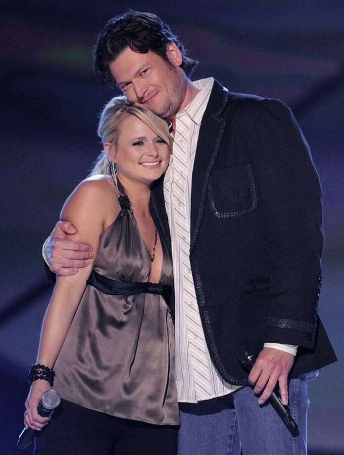 In this April 6, 2009, file photo, country singers Miranda Lambert, left, and Blake Shelton embrace after performing at the ACM Artist of the Decade All Star Concert in honor of George Strait in Las Vegas. (AP) Photo: ASSOCIATED PRESS / AP2009