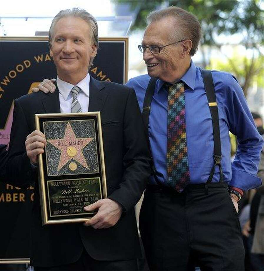 Comedian and television host Bill Maher, left, is joined by broadcaster Larry King after he received a star on the Hollywood Walk of Fame in Los Angeles, Tuesday, Sept. 14, 2010. (AP Photo/Chris Pizzello) Photo: AP / AP