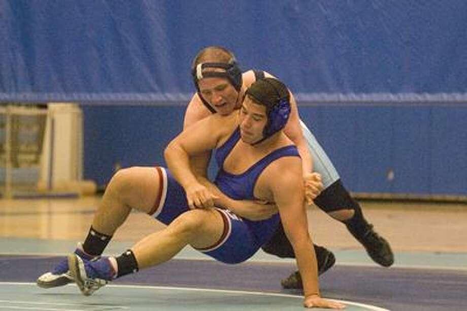 Jordan Tharp, top, of Middletown wrestles Ivan Santiago of Glastonbury Dec. 17 at Middletown High School. (Max Steinmetz / Special to the Press)